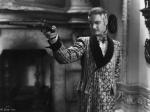 Robert Donat Aiming a Muzzle-Loader Gun